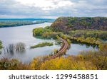 above mississippi river and woodlands during autumn at iowa border and wisconsin in distance