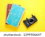disassembled old retro camera... | Shutterstock . vector #1299506647