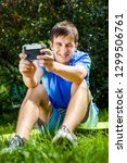 happy young man take a selfie... | Shutterstock . vector #1299506761