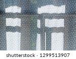 cozy village window | Shutterstock . vector #1299513907
