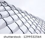 metal fence mesh covered with... | Shutterstock . vector #1299532564