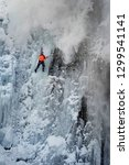 Small photo of An avalanche is coming off, training of athletes on the frozen famous Manyavsky waterfall in Manyava - Ukraine, Carpathians before going to the Alps climbing expedition to the glaciers
