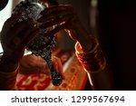 silver mirror in hands of hindu ... | Shutterstock . vector #1299567694