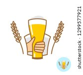 beer glass with hand and wheat... | Shutterstock .eps vector #1299577921