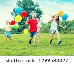 four friendly glad kids happily ... | Shutterstock . vector #1299583327