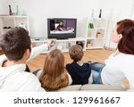 young family watching tv... | Shutterstock . vector #129961667