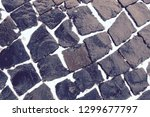 cobbles in the snow. patterned...   Shutterstock . vector #1299677797