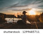 the girl smokes a hookah on the ... | Shutterstock . vector #1299685711