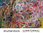 multi colored tangled threads... | Shutterstock . vector #1299729931