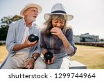 senior woman in hat laughing... | Shutterstock . vector #1299744964