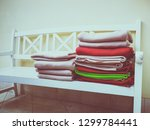 Folded Colored Bedspreads On...
