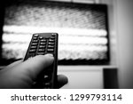 female hand holding tv remote... | Shutterstock . vector #1299793114