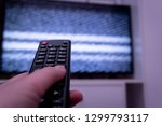 female hand holding tv remote... | Shutterstock . vector #1299793117