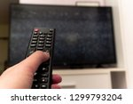 female hand holding tv remote... | Shutterstock . vector #1299793204