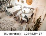 couple enjoying process.... | Shutterstock . vector #1299829417