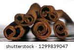 cinnamon sticks close up.... | Shutterstock . vector #1299839047