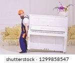 loader moves piano instrument....   Shutterstock . vector #1299858547