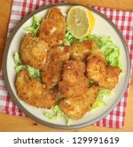 Italian chicken fillets fried in breadcrumbs, oregano and parmesan cheese. - stock photo