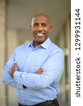 african american man smiling at ...   Shutterstock . vector #1299931144