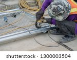 worker wear mask and gloves for ... | Shutterstock . vector #1300003504