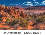 A colorful southern winter sun shines on the Fiery Furnace area as well as the La Sal Mountains in Arches National Park near Moab, Utah, United States.