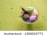 a cup of ice cream with rolled... | Shutterstock . vector #1300024771