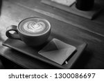 a cup of coffee with a heart... | Shutterstock . vector #1300086697