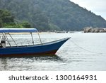tourist boat moored by the sea... | Shutterstock . vector #1300164931
