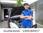 asian repairman or auto... | Shutterstock . vector #1300184017