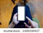 women's hands holding cell... | Shutterstock . vector #1300230427