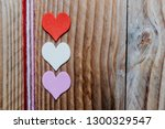 Three Colored Hearts On A...