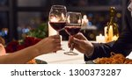 hands holding glasses of wine... | Shutterstock . vector #1300373287