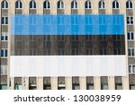 Huge estonian flag on the building - stock photo