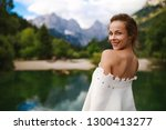 young happy woman on the lake | Shutterstock . vector #1300413277