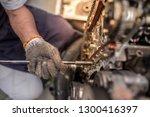 closeup repair of an opposing... | Shutterstock . vector #1300416397