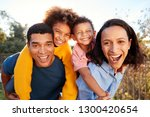 young mixed race parents... | Shutterstock . vector #1300420654