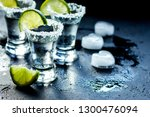 tequila shot with salt and ice... | Shutterstock . vector #1300476094