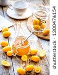 kumquat on plate and jam in jar ...   Shutterstock . vector #1300476154