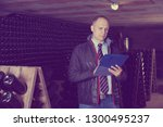 confident male winemaker... | Shutterstock . vector #1300495237