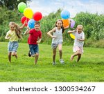 glad boy and girls holding air... | Shutterstock . vector #1300534267