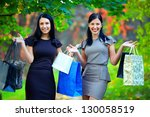beautiful elegant women after shopping, colorful outdoors - stock photo