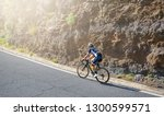 a man road cyclist   attacking... | Shutterstock . vector #1300599571