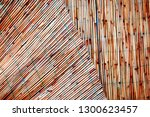 crinkled bamboo fence texture... | Shutterstock . vector #1300623457