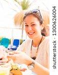 tourist having lunch | Shutterstock . vector #1300626004