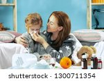 sick woman with daughter at... | Shutterstock . vector #1300711354