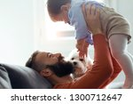 shot of handsome young father... | Shutterstock . vector #1300712647