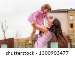happy mother with a child...   Shutterstock . vector #1300903477