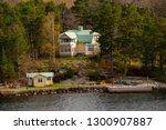 lake house   castle by lake | Shutterstock . vector #1300907887