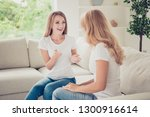 Small photo of Close up photo of two people mum and teenager daughter sit on sofa tell speak funny episode moment glad sharing parenthood mommy knows all secrets wear white t-shirts jeans