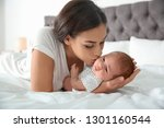 young woman with her newborn... | Shutterstock . vector #1301160544